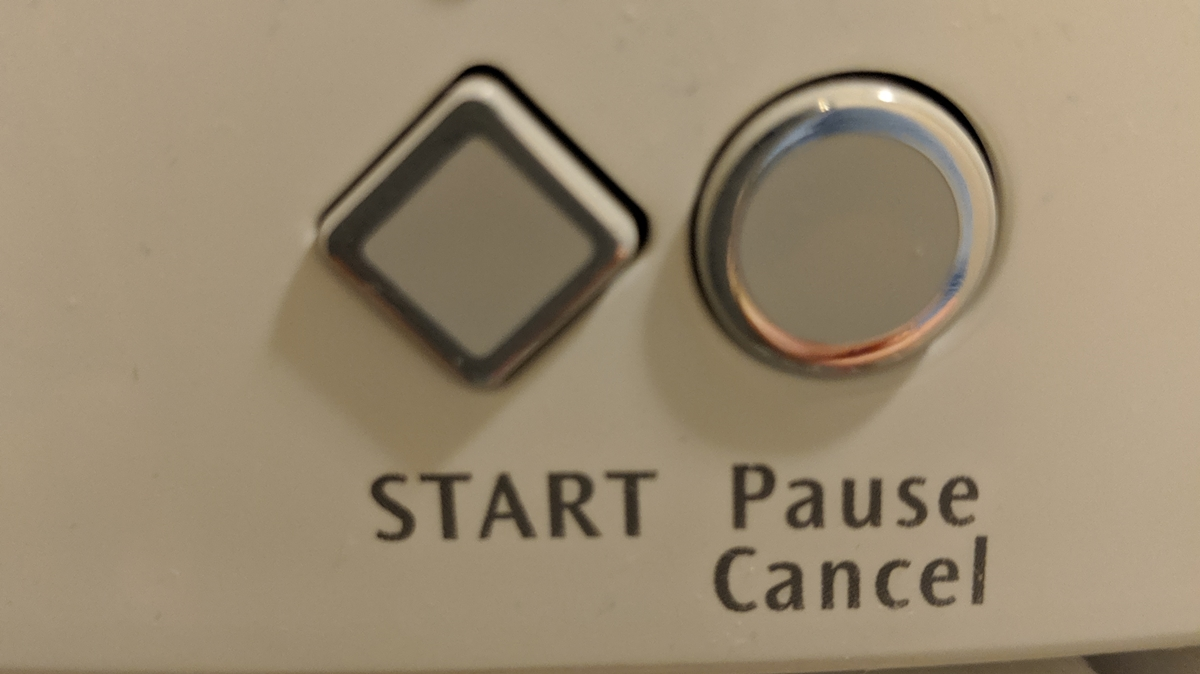 closeup of a start button on a machine